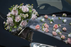 Wedding car decoration. With flowers and ribbons Stock Images