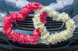 Wedding car decoration in the form of hearts. From flowers Royalty Free Stock Photography
