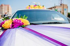 Wedding car decoration.  Gold rings Stock Image
