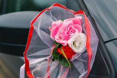 Wedding car decoration, rear-view mirror and artificial flowers stock photography