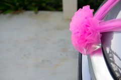 Wedding car decorations with pink bow Royalty Free Stock Photos