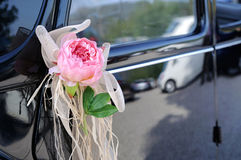 Wedding car with flower and white bow Royalty Free Stock Images