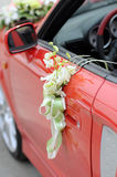 Wedding Car Flowers. Flowers on a red wedding car Royalty Free Stock Photo