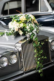 Wedding Car Front. Flowers at the front of a wedding car Royalty Free Stock Photos