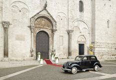 Wedding car in front of church Royalty Free Stock Image