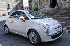 Wedding car in Italy. Fiat 500 decorated for wedding in the Historic center of Castellina in Chianti, Tuscany, Italy, Europe Stock Image