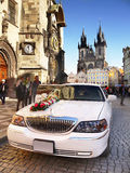Wedding Car, Old Town Hall, Prague. Wedding decoration on white limousine standing in front of Old Town Hall in Prague Royalty Free Stock Photos