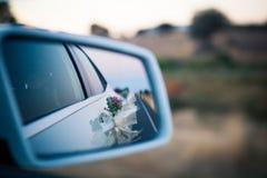 Wedding car rear mirror. Royalty Free Stock Images