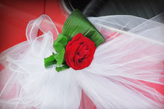 Wedding car. Red rose on a wedding car Stock Photography
