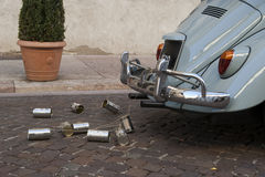 Wedding car with tin cans. Wedding vintage car with tin cans on cobblestone Stock Photography