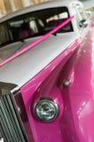 Wedding car. Vintage wedding car with pink ribbon Royalty Free Stock Image