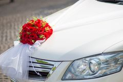 Wedding car.Wedding decoration on wedding car.Luxury wedding car decorated with flowers. Just married sign and cans attached Stock Images