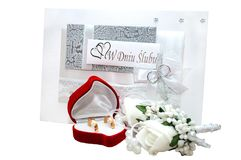 Wedding card is isolated from white. Wedding rings in a heart-shaped red box are isolated from white. Great idea for scrapbooking and wedding album making Stock Images