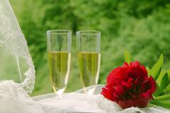 Wedding card with a red peony, wedding veil and champagne Stock Photo