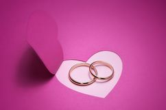 Wedding card with rings. Wedding background for design with gold rings Stock Images