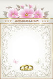 Wedding card with rings Stock Photography