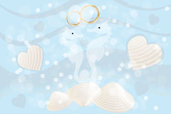Wedding card with seahorses and rings Stock Photos