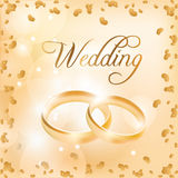 Wedding card with wedding rings Stock Images