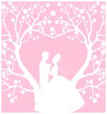 Wedding cardwith groom and bride. Laser cut Stock Photos