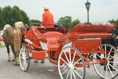 Wedding carriage. The red wedding carriage with the driver and pair horses Stock Images