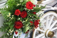 Wedding Carriage With Huge Bouquet On Side. Flowerful wedding carriage with huge bouquet on side. The wedding day is one of the most special days in life. Focus Royalty Free Stock Photos
