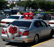 Wedding cars. With flowers and heartlet ornament Stock Photography