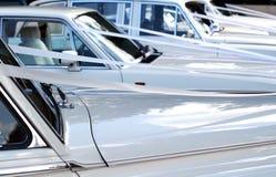 Wedding cars. Row of white wedding cars with ribbon Stock Photo