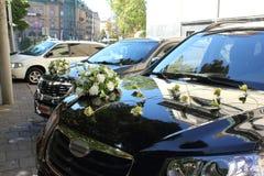 Wedding cars abreast