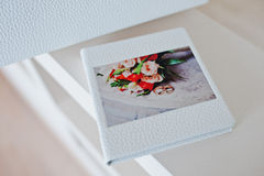 Wedding CD or flash box with photo of wedding bouquet with rings stock image