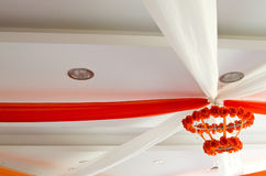 Wedding ceiling. Decoration with orange and white ribbons Stock Photography