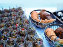 Catering banquet table with different food snacks and appetizers in glass on corporate event, christmas, birthday, royalty free stock image