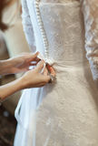 Wedding celebration ceremony morning bride dressing gown hand pr Royalty Free Stock Photography