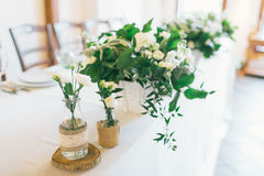 Wedding centerpiece and decorated bottle with flower Royalty Free Stock Photos