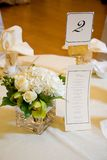Wedding Centerpiece and Menu. Wedding centerpiece with banquet menu Royalty Free Stock Photo
