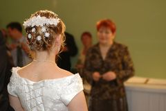 At the Wedding Ceremony. Pride standing in front of the �altar�, picture taken from back Royalty Free Stock Photography
