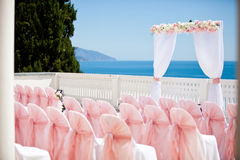 Wedding ceremony. Wedding with chairs, arch and sea in background Royalty Free Stock Photos