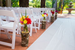 Wedding Ceremony Aisle Seating. White chairs and rows of seating create a nice venue for the bride to walk down the aisle at this wedding ceremony royalty free stock image