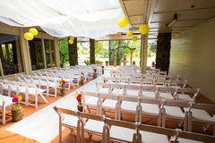 Wedding Ceremony Aisle Seating. White chairs and rows of seating create a nice venue for the bride to walk down the aisle at this wedding ceremony royalty free stock photo