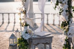 Wedding ceremony arch it the beautiful lake place. Details of decoration.  Royalty Free Stock Photos