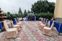 Wedding ceremony with an arch and chairs. Place for a wedding ceremony with an arch and chairs Royalty Free Stock Photography