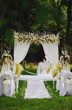 Wedding ceremony in a beautiful garden royalty free stock images