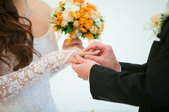 Wedding ceremony, the bride and groom exchange rings. Royalty Free Stock Images