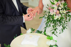 Wedding ceremony, the bride and groom exchange rings. royalty free stock photography