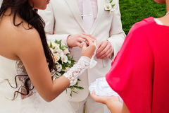 The wedding ceremony, the bride and groom exchange rings. Wedding photograph of the wedding ceremony, the moment when the bride wears a wedding ring to the Stock Image