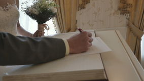 The wedding ceremony. The bride and groom. The interior is beautiful, Russia, rings stock video footage