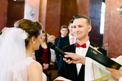 Wedding ceremony in catholic church. Marriage vow. Wedding day Stock Photography