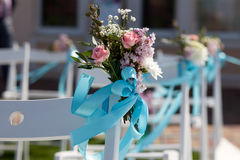 Wedding ceremony chairs and a bouquet of roses Royalty Free Stock Photos
