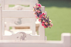 Wedding ceremony chairs. And a wreath of roses Stock Photos
