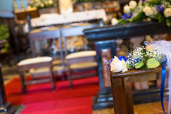 Wedding ceremony in church. Beautiful flowers wedding decoration in a church Stock Image