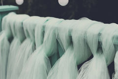 Wedding ceremony decor details, turquoise curtain. On wooden background, outdoors, close-up, shallow depth of field Stock Photos